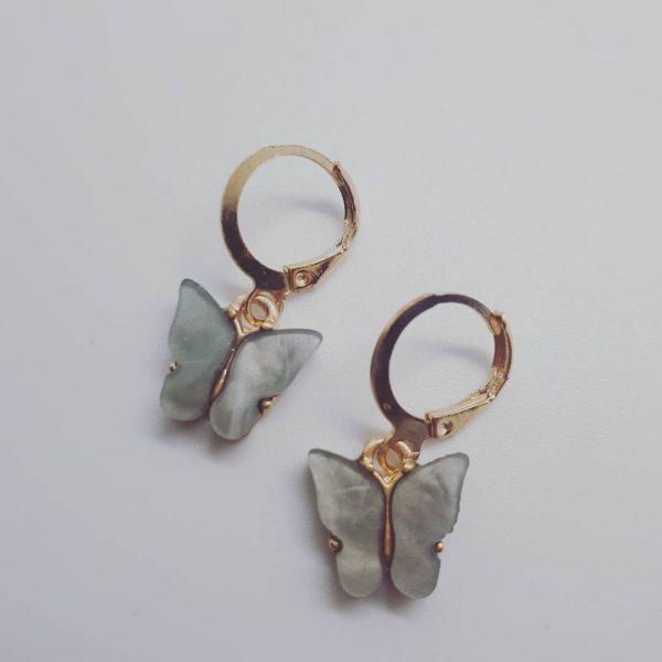 vlinder oorbellen grijs