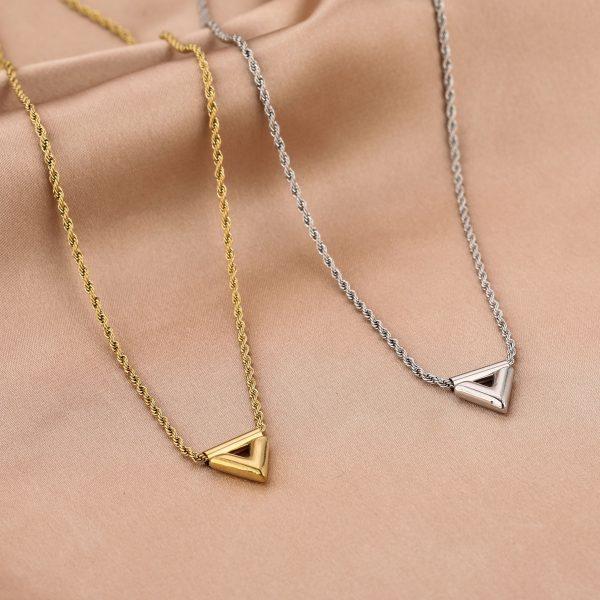 twisted v necklace gold en silver